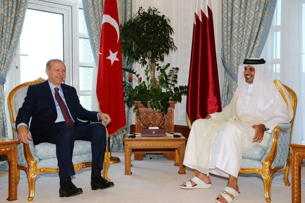 President Erdogan (L) meets with Qatari Emir Sheikh Tamim bin Hamad al-Thani (R), in Doha, Qatar, Nov. 15.
