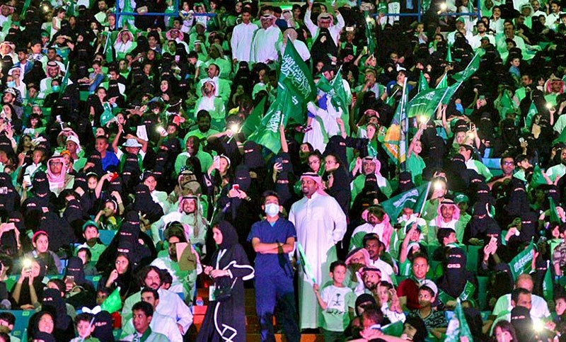 In this Sept. 23, 2017 file photo released by Saudi Press Agency, SPA, Saudi men and women attend national day ceremonies at the King Fahd stadium in Riyadh, Saudi Arabia (AP File Photo)