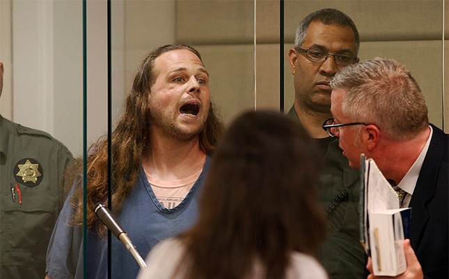 A convicted felon, Jeremy Christian, 35, who fatally stabbed two men who tried to stop him from harassing a pair of Muslim women, shouts during an appearance in Multnomah County Circuit Court in Portland. (Reuters Photo)