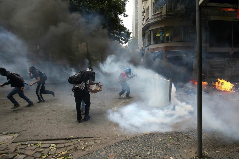 Protesters face off with police during a demonstration, in Rio de Janeiro, Brazil, Feb. 9.