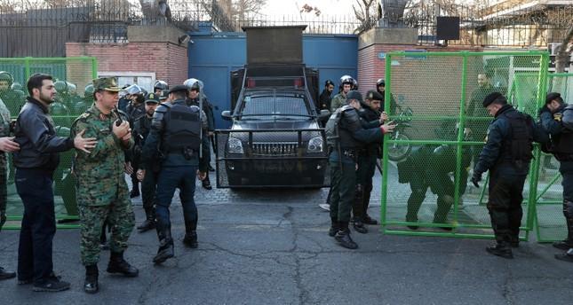 Police guard the British Embassy during an anti-UK protest in Tehran, Iran, Sunday, Jan. 12, 2020. AP Photo