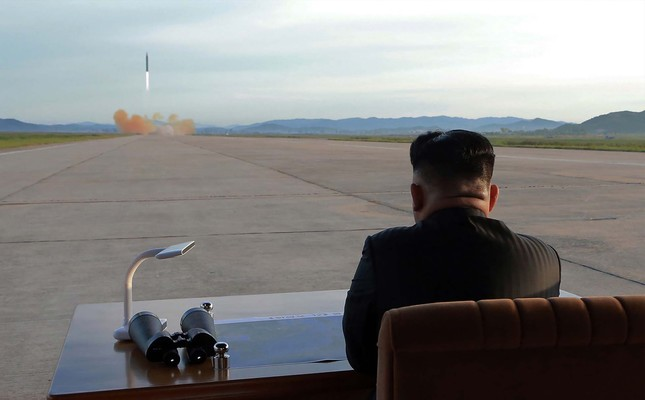 North Korean leader Kim Jong Un inspectes a launching drill of the medium-and-long range strategic ballistic rocket Hwasong-12 at an undisclosed location, Sept. 16.