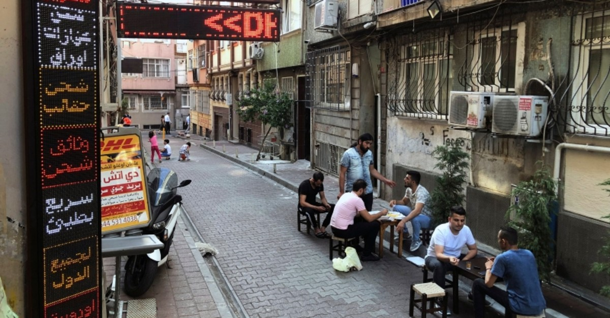 In this photo taken on July 31, 2019, Syrians pass time at a coffee shop in an Istanbul neighborhood where many Syrians live. (AP Photo)