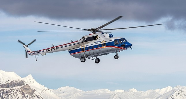 A view shows the Russian-made Mil Mi-8 helicopter, that went missing Oct. 26, 2017 with eight people aboard off the coast of the Arctic Svalbard archipelago, in the settlement of Barentsburg on Svalbard, Norway April 28, 2015. (Reuters Photo)
