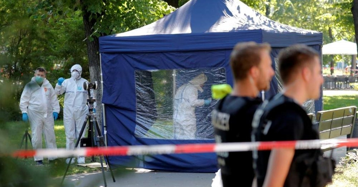 Police officers investigate a crime scene in Berlin, Germany, Aug. 23, 2019, after a cyclist shot at a man in the Moabit district. (Reuters Photo)