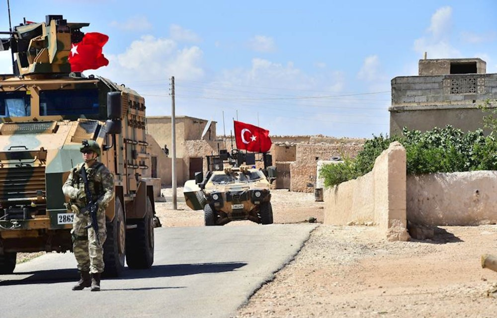 Turkishsoldiers accompanied by armored vehicles patrolling between the city of Manbij in northern Syria and an area it controls after a 2016-2017 military incursion, June 18.