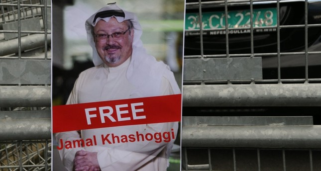 A picture of journalist Jamal Khashoggi is seen posted on a police fence during a demonstration in front of the Saudi Consulate in Istanbul, Oct. 8.