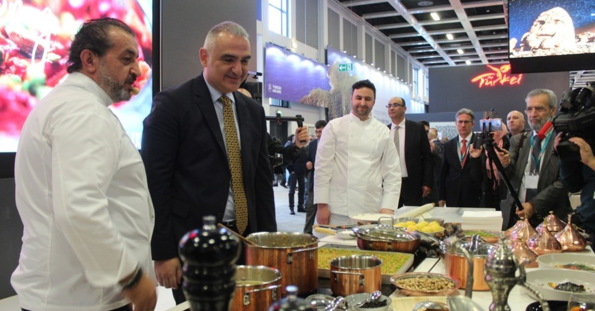 Culture and Tourism Minister Mehmet Nuri Ersoy, second from left, visits Turkish booths at the 53rd ITB Berlin, the world's largest travel show, March 7, 2019.