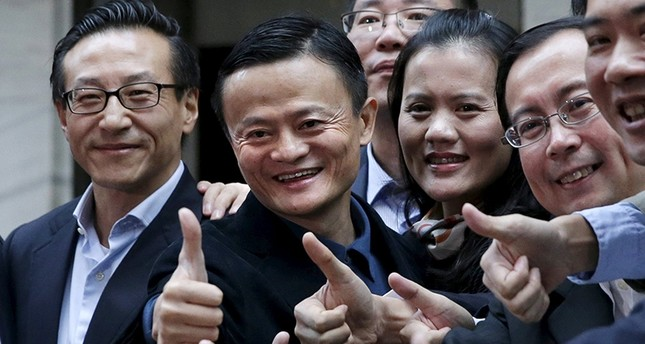 Alibaba Group Holding Ltd founder Jack Ma 2nd L poses as he arrives at the New York Stock Exchange for his company's initial public offering IPO under the ticker BABA in New York Reuters Photo