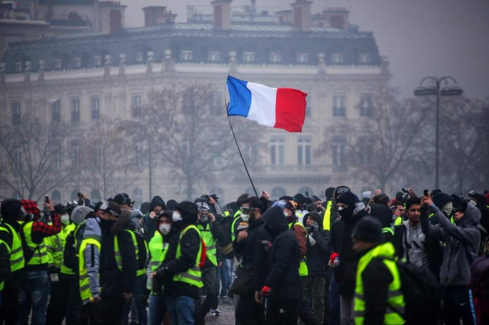 Demonstrators gather near the Arc de Triomphe in central Paris during a protest by the ,yellow vest, movement against rising fuel prices and living costs, Paris, Dec. 1.