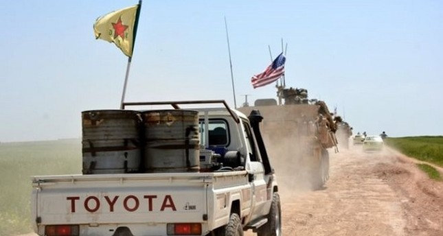 A convoy of U.S. army troops and YPG terrorists patrol close to the al-Ghanamya village, near the Syrian-Turkish border, Syria, April 29.