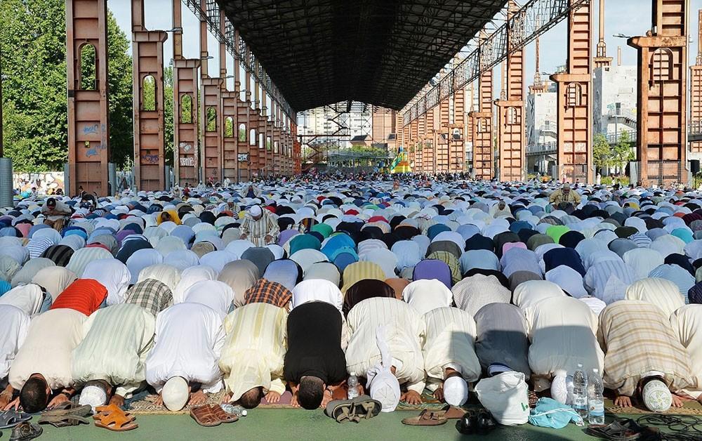 Muslims attend Eid al-Fitr mass prayers in Turin, northern Italy