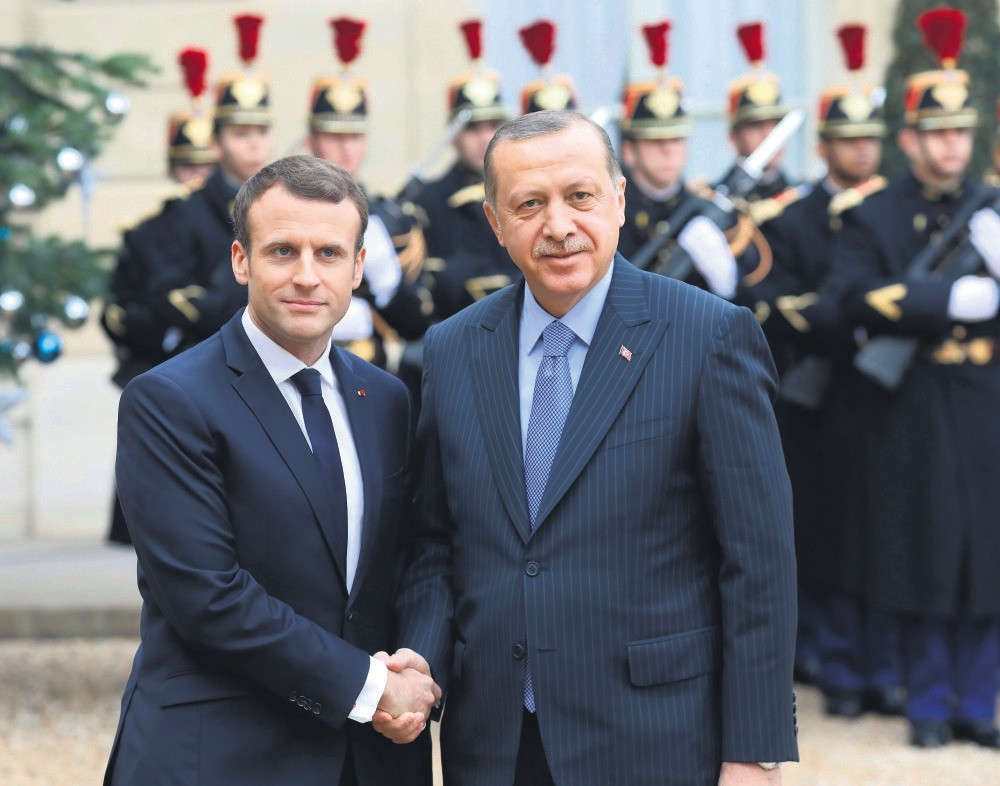 President Recep Tayyip Erdou011fan is welcomed by French counterpart Emmanuel Macron upon his arrival for their meeting and luncheon at the Elysee Palace, Paris, Jan. 5.