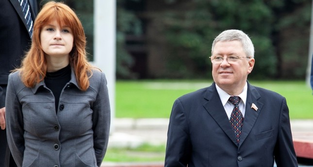 In this photo taken on Friday, Sept. 7, 2012, Maria Butina walks with Alexander Torshin then a member of the Russian upper house of parliament in Moscow, Russia. (AP Photo)