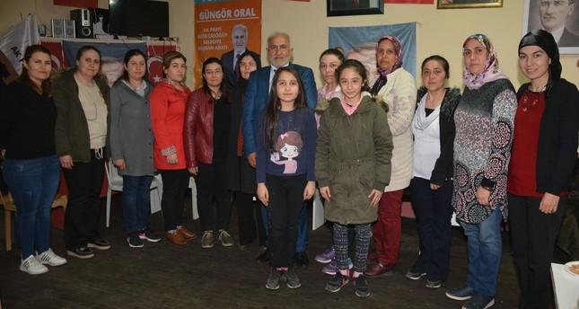 Güngör Oral, the AK Party's mayoral candidate for the Kızılcasöğüt district of Uşak (C), alongside the women municipal council candidates for the district, March 8, 2019.