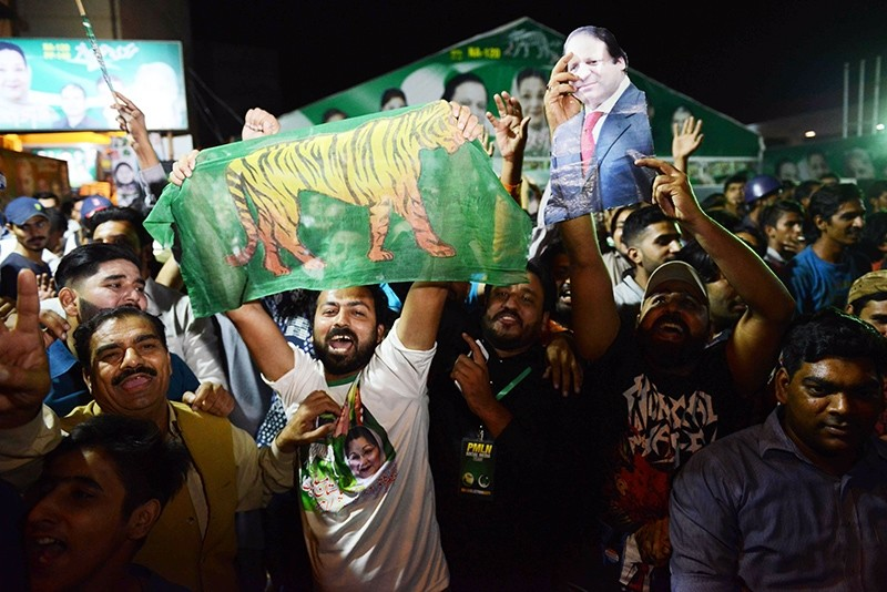 Activists of former Pakistani prime minister Nawaz Sharif party celebrate victory in by-election in Lahore, Pakistan, Sept. 17, 2017. (AFP Photo)