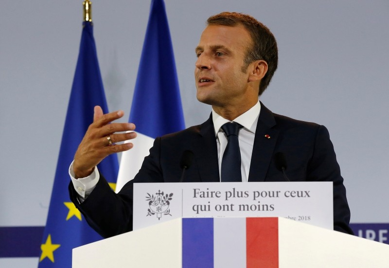 French President Emmanuel Macron delivers a speech on poverty to social aid workers in Paris, France, 13 September 2018. (EPA Photo)
