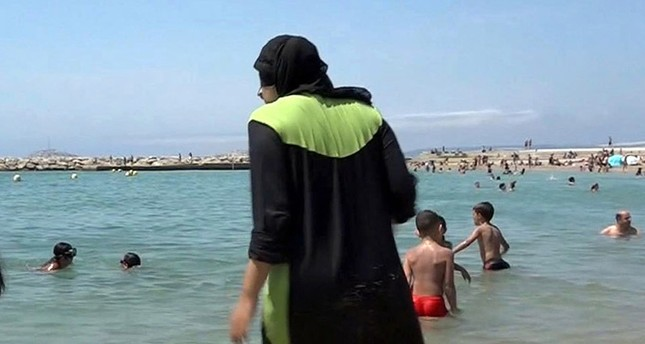 n this Aug. 4 2016 file photo made from video, Nissrine Samali, 20, gets into the sea wearing a burkini, a wetsuit-like garment that also covers the head, in Marseille, southern France (AP Photo)