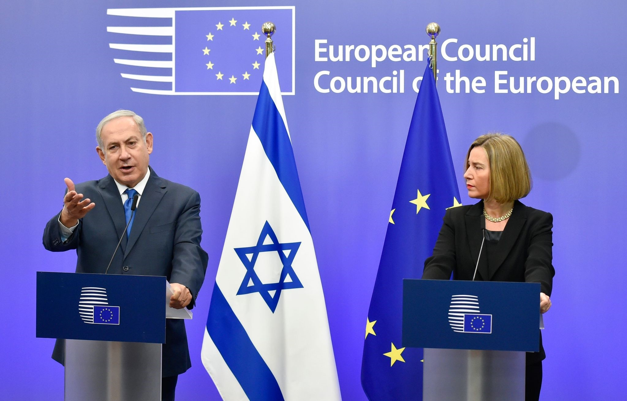 Israel's Prime Minister Benjamin Netanyahu speaks as EU foreign policy chief, Federica Mogherini looks on during a press conference at the European Council in Brussels on December 11, 2017. (AFP Photo)