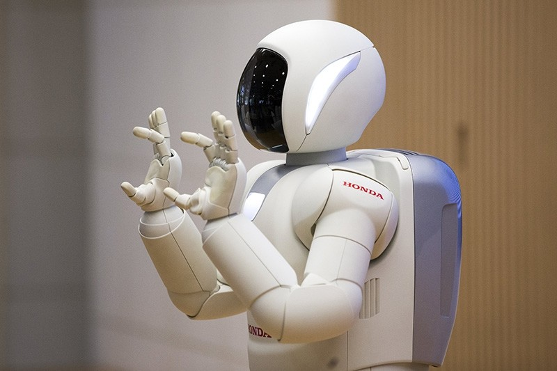 The robot Asimo of Japanese company Honda gestures during a demonstration for Swiss Federal President Alain Berset, during his three day official visit to Japan, in Tokyo, Japan, April 13, 2018. (EPA Photo)