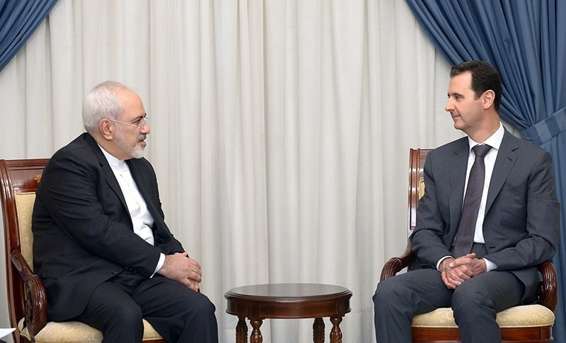 A handout picture released by the official Syrian Arab News Agency (SANA) shows Syrian President Bashar al-Assad (R) meeting with Iranian Foreign Minister Mohammad Javad Zarif in Damascus on Aug. 12, 2015. (AFP Photo)