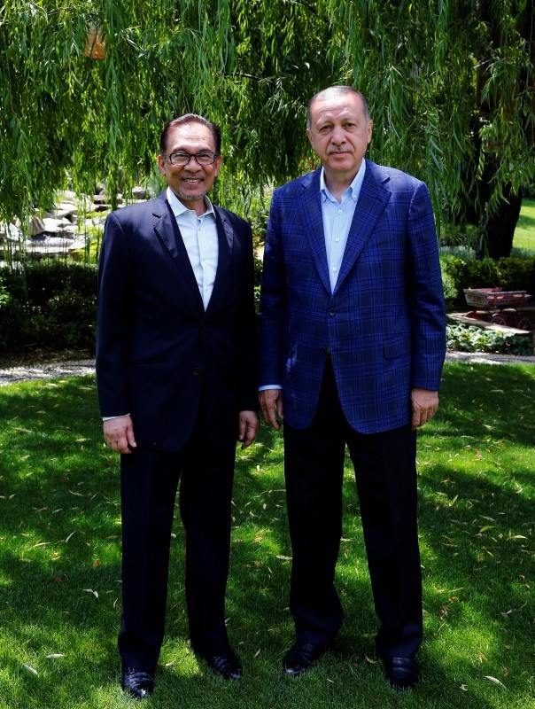 President and ruling Justice and Development Party's (AK Party) leader Recep Tayyip Erdou011fan, right, and Malaysia's ruling coalition leader PM Anwar Ibrahim pose for a photo before a meeting in Istanbul, Wednesday, June 20, 2018.