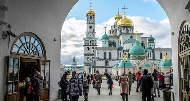 Visitors enter the New Jerusalem Orthodox Monastery near the town of Istra, 70 km outside Moscow (AFP Photo)