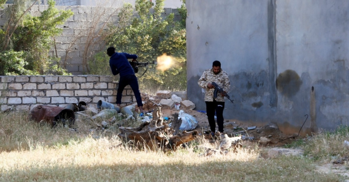 A member of the Libyan internationally recognised government forces fires during a fight with Eastern forces in Ain Zara, Tripoli, Libya April 28, 2019. (Reuters Photo)