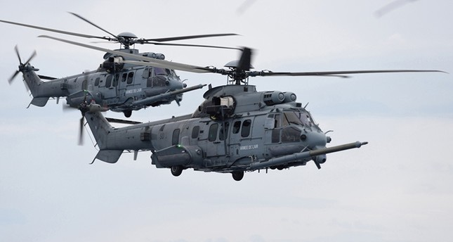 This handout file photo taken and released by Sirpa Air on June 6, 2016 shows French Caracal helicopters flying during an air-to-air refuelling exercise. (AFP Photo)