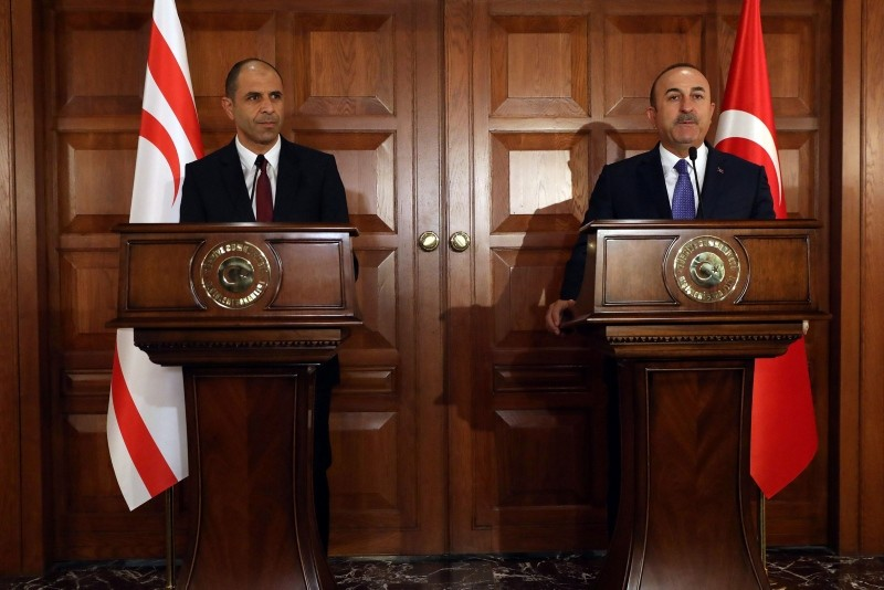 Foreign Minister Mevlu00fct u00c7avuu015fou011flu (R) holds a joint press conference with his Deputy Prime Minister of the Turkish Republic of Northern Cyprus and Minister of Foreign Affairs Kudret u00d6zersay following their meeting in Ankara. (AFP Photo)