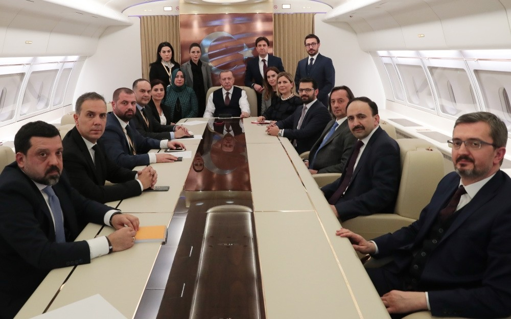 President Recep Tayyip Erdou011fan with journalists on his flight from Russia to Turkey, Feb.14, 2019.