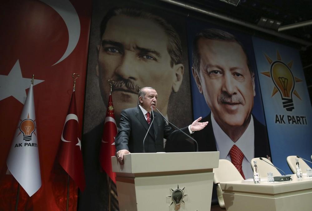 In front of posters of Turkey's founding leader, Mustafa Kemal Atatu00fcrk, and himself, President Erdou011fan addresses provincial leaders of his party, Ankara, Nov. 17.