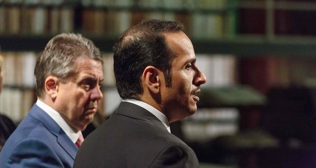 German Foreign Minister Sigmar Gabriel (L) and Qatari Foreign Minister Mohammed bin Abdulrahman bin Jassim al-Thani attend a press conference. (AFP Photo)