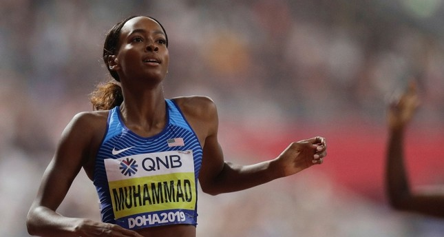 Dalilah Muhammad of the United States wins the gold medal in the women's 400 meter hurdles final at the World Athletics Championships in Doha, Qatar, Friday, Oct. 4, 2019. (AP Photo)