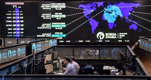 Traders work at their desks on the floor of the Borsa Istanbul in Istanbul, May 22.
