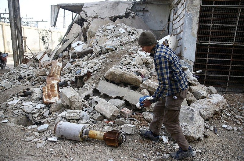 A man is seen near the remains of a rocket in Douma, Eastern Ghouta in Damascus, Syria January 22, 2018. (Reuters Photo)