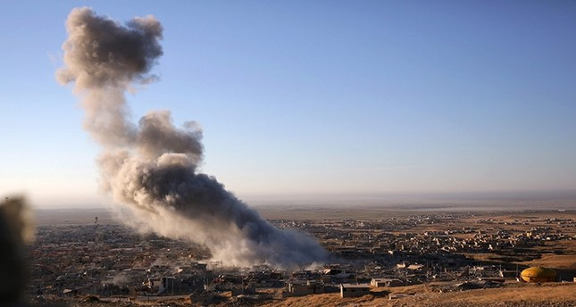 In this Thursday, Nov. 12, 2015, file photo, smoke believed to be from an airstrike billows over the northern Iraqi town of Sinjar. (AP Photo)