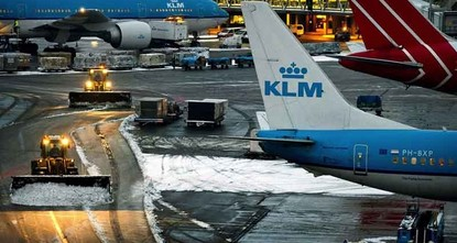 pAmsterdam's Schiphol Airport suspended all flights for nearly an hour Thursday and the Dutch national rail service halted trains across the country as a powerful storm battered the Netherlands and...