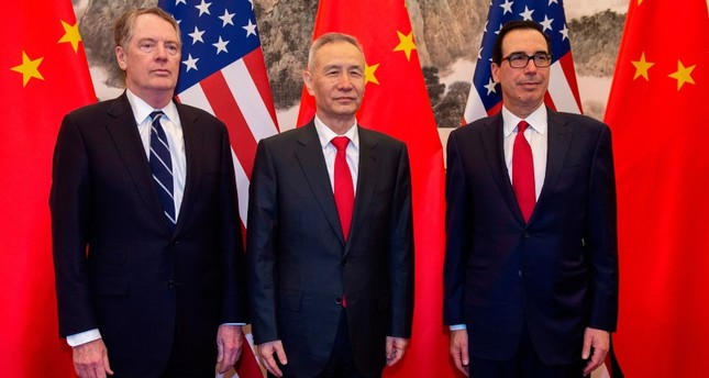In this file photo taken on March 28, 2019 China's Vice Premier Liu He C poses for a photo with US Treasury Secretary Steven Mnuchin R and US Trade Representative Robert Lighthizer L at Diaoyutai State Guesthouse in Beijing. AFP Photo
