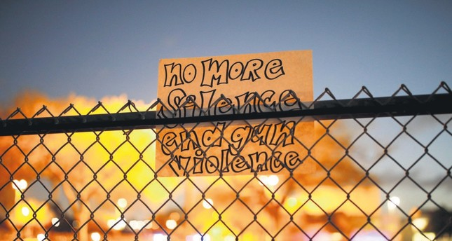 A note on the fence of Marjory Stoneman Douglas High School following a mass shooting, in Parkland, Florida, Feb. 21.