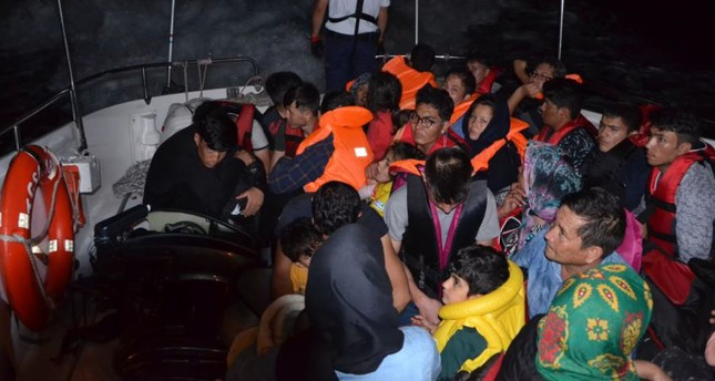 Migrants aboard a Coast Guard Command boat after they were intercepted off the coast of İzmir, July 11, 2019.
