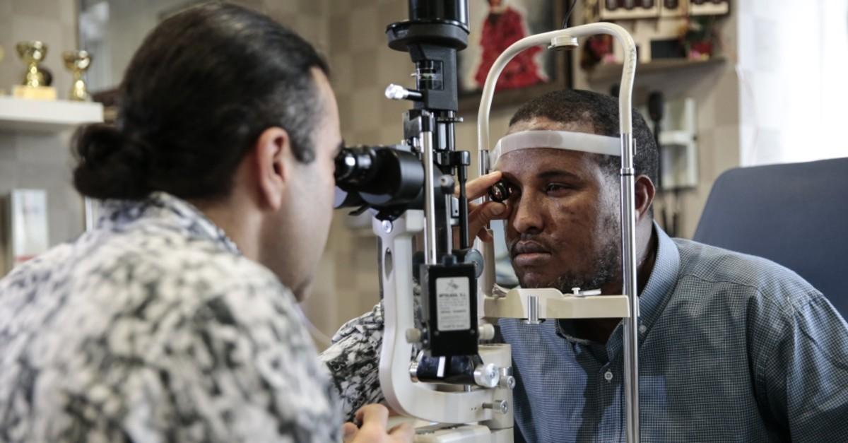 Dr. Kubilhan Elmas examines Ahmed at the hospital, June 23, 2019.
