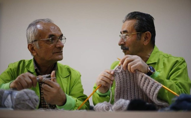 Two men are seen knitting at Senior Citizens University founded to encourage active aging in Antalya in this undated photo. (AA Photo)