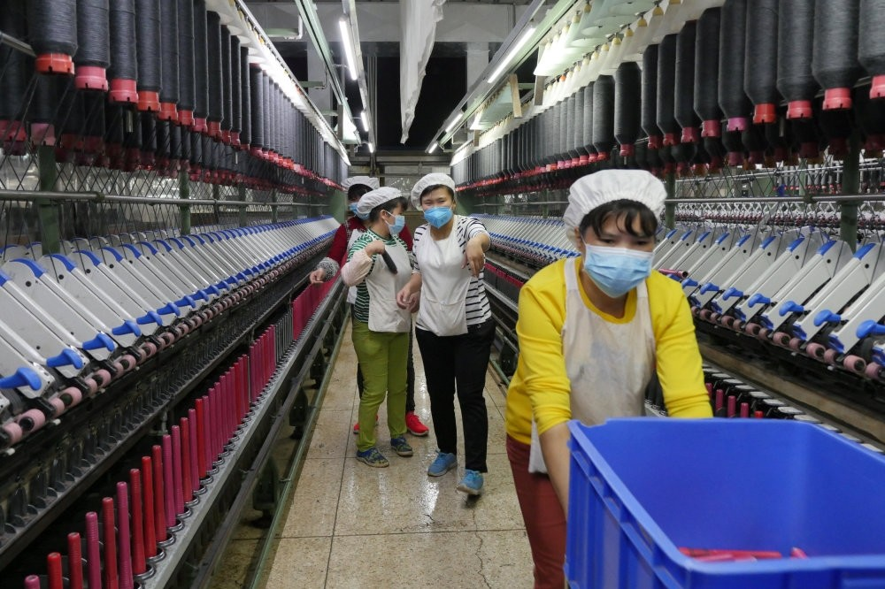 The increasing cost of doing business in China work against Chinese textile industry but earns benefits for the Italian suppliers.