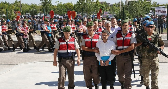 Soldiers escort Kemal Batmaz to the courthouse for a hearing of the main coup trial in Ankara.