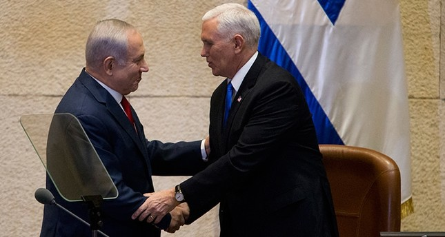 Israel's Prime Minister Benjamin Netanyahu, left, shake hands with U.S. Vice President Mike Pence in Israel's parliament in Jerusalem, Jan. 22, 2018. (AP Photo)