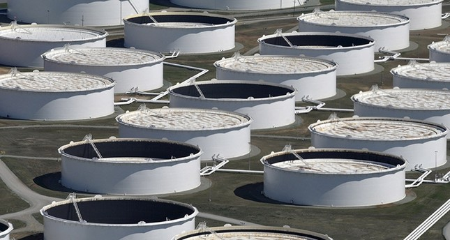 Crude oil storage tanks are seen from above at the Cushing oil hub, appearing to run out of space to contain a historic supply glut that hammered prices, in Cushing (Reuters Photo)