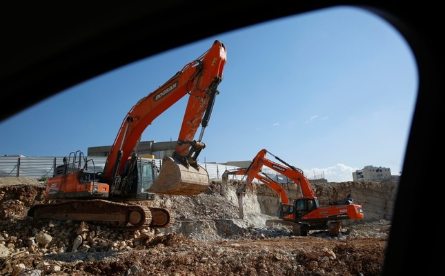 In this Tuesday, Jan. 1, 2019 photo, men work on a new housing project in the West Bank settlement of Modin ilit. (AP Photo)
