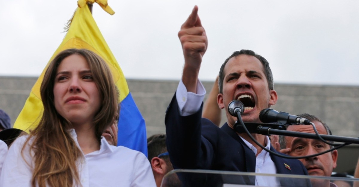 Juan Guaido speaks to supporters at a rally to demand the resignation of Venezuelan President Nicolas Maduro, as his wife Fabiana Rosales next to him in Caracas, Venezuela, March 4, 2019. (AP Photo)