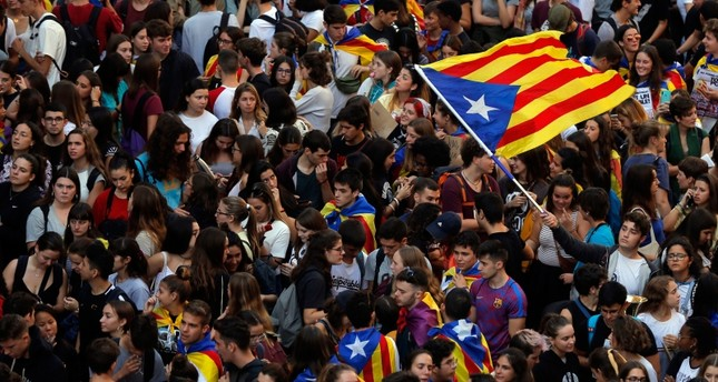 Students wave a Catalan pro-independence estelada flag as they protest during a demonstration in front of the police headquarters in Barcelona, Oct. 17, 2019. (AFP Photo)